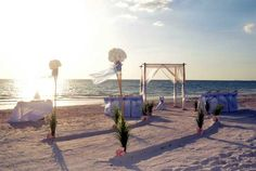A Florida Beach Wedding Dream - Suncoast Weddings present a Ffur post bamboo arch with canopy style draping, a sweeping aisle and blue sashes .... anyone feel like proposing?