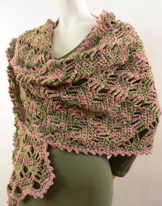 "Use this experienced crochet pattern to create an intricate lace shawl in a lattice design. The unique ""painted"" yarn adds to the crochet lace design."