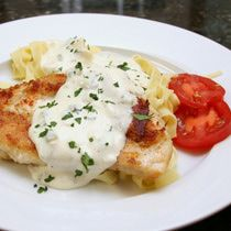 Chicken With Creamy Parmesan Sauce. I also added about half a tub of Garlic/Herb cream cheese
