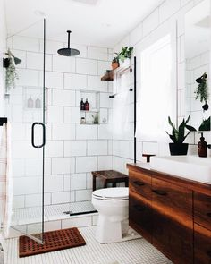 Classic Towels - Floor Plants - Ideas of Floor Plants - These bathroom tiles are to die for. Wide subway tiles in the shower and small squares across the floor with a stunning natural wood vanity and plenty of plants. Bathroom Renos, Bathroom Renovations, Bathroom Interior, Master Bathrooms, Remodel Bathroom, Bathroom Cabinets, Bathroom Mirrors, Dyi Bathroom, Small Bathrooms