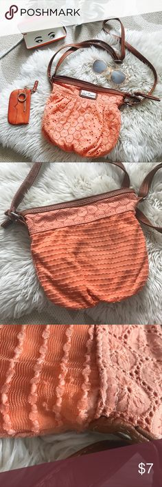 Coral colored lace Wallflower shoulder bag purse Summer bag. ☀️ Peach orange in color. Brown faux leather adjustable strap. Used condition. Interior lining clean with one one zipper and two pockets.  Bundle and save. 3 items for 15% discount plus save on shipping. Wallflower Bags Shoulder Bags