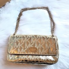 "Michael Kors Siganture Handbag Beautiful Michael Kors pale gold Siganture handbag. Authentic. Has normal wear, difficult to photograph, please see all pics. No stains or tears inside or out. Dust Bag included. Clean, Smoke Free Home.  All Sales Final.  Fast Ship! Thanks! Check out my other items!                                                ✨✨✨✨✨15% off when bundled with another listing ✨✨✨✨  **NO TRADES or HOLDS PLZ** **will not reply to ""lowest""** Michael Kors Bags Shoulder Bags"