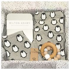 Penguins perfectly packaged up at Young Willow all ready to spoil a new baby. Monochrome selections from Kapow and Milton Ashby, plus a gorgeous buttery soft teething toy from Naturebubz.