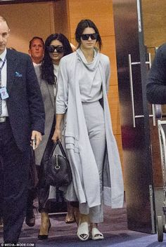 Stylish sisters: Dressed in the same outfits they wore to board their flight, Kendall led the way in a grey jumpsuit and matching long coat Maxi Coat, Kendall And Kylie Jenner, Fashion Models, Celebrity Style, Fashion Looks, Stylish, Sisters, How To Wear, Jumpsuit