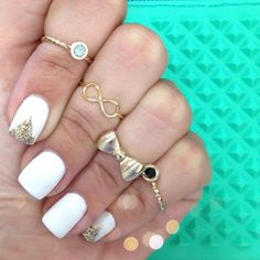 white nails with gold triangles manicure. Like what nails the triangles are on