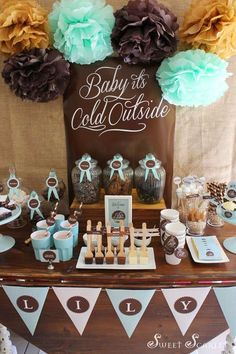 Hot Cocoa Bar party idea. Love the tissue pom background but could customize to any colors.