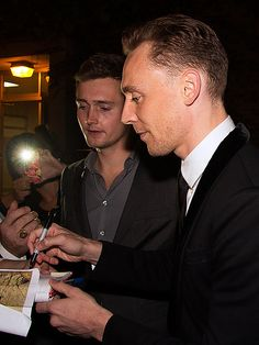 Tom Hiddleston being sweet... I believe that's Luke there in the background!<<< It is!