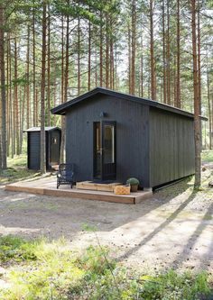 Love the matching outhouse. Tyni House, Dark House, Tiny House Cabin, Tiny Cabins, Cabins And Cottages, Little Cabin, Little Houses, Metal Building Homes, Building A House