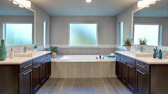 "Contemporary Master Bathroom with Underscore 60"" x 30"" Soaking Bathtub by Kohler, Flat panel cabinets, Limestone counters"