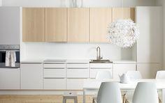 FAKTUM kitchen with APPLÅD white doors/drawers and NEXUS birch veneer doors