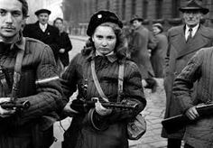 Erika, a girl, a Hungarian Freedom Fighter, carries a machine gun in Budapest during the revolution, she was eventually shot by the Soviets (via chaplinnn) Famous Photos, Photos Du, Military Women, Military History, Freedom Fighters, Badass Women, Women In History, Ancestry, Budapest Hungary