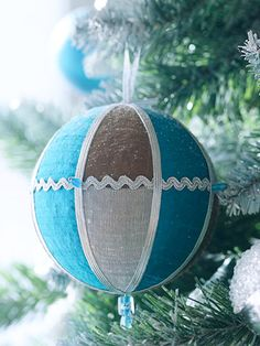 Love blue & brown for Christmas decorating.  Make your own foam plastic ornaments with some leftover fabric.