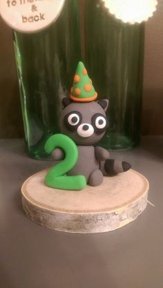 Raccoon cake topper for a 2nd birthday