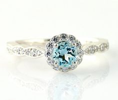 14K Aquamarine Engagement Ring Aquamarine Ring by RareEarth, $925.00. I am in LOVE with this ring, just wish it was sapphire.