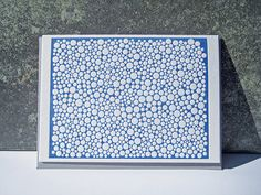 """Blue White Dots"" by Pepper Press."