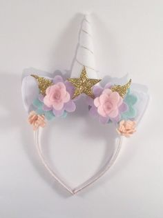 Gold unicorn party headband - Lilly by LittleLapins on Etsy https://www.etsy.com/listing/501844143/gold-unicorn-party-headband-lilly
