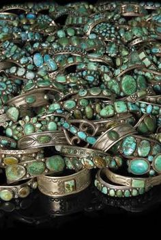 A vintage selection of turquoise and silver Navajo bracelets from the collection of Everett and Martha Thomas