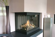 Corner Fireplace Design - I like the part under the fireplace