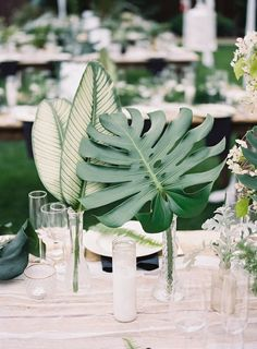 Tropical Foliage as wedding dinner table centrepiece