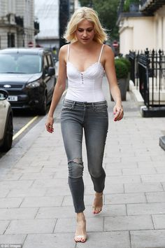 Pixie Lott flaunts slim figure in jeans and vest top as she arrives at West End theatre | Daily Mail Online