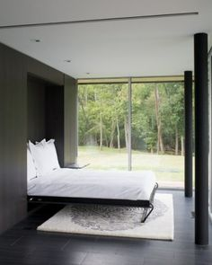 A beautiful way to create a dual-purpose room allowing comfortable living space for guests.