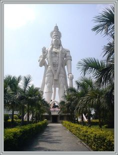 """135 feet staggering height colossal sky-high world tallest statue in depicting Lord Hanuman as """"Veera Abhaya Anjaneya Hanuman Swami"""" is located at PARITALA village belongs to Kanchikacherla Mandal under KRISHNA district near VIJAYAWADA in the Indian state of ANDHRA PRADESH. Paritala is situated 99 kms towards west from district head quarters Machilipatnam, about 6 kms away from Kanchikacherla, approx. 30 kms from the city Vijayawada and 240 kms from the state capital city HYDERABAD on NH-9."""