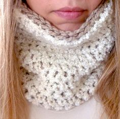 This cozy little neck warmer whips up fast, and it's double-sided, so when you're finished, it's essentially two neck warmers in one. I used a boucle yarn on the inside, giving the impression of a sheepskin lining, but you can use any type of yarn you want. If you don't have bulky yarn on hand, you can try using two strands of worsted weight yarn, although I can't vouch for the results.