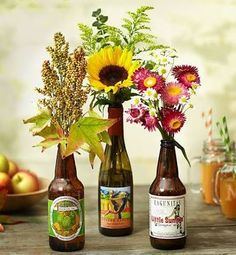 flowers in beer and wine bottles
