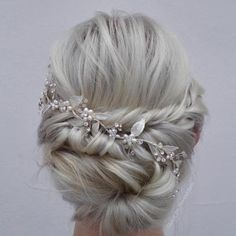 Low messy bun with fishtail braid; perfect wedding updo for my thin hair!