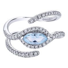 The eagle eye ring is made of white gold welcomes only a loving gaze. A charmed alternative to traditional rings with a sky blue topaz center stone.