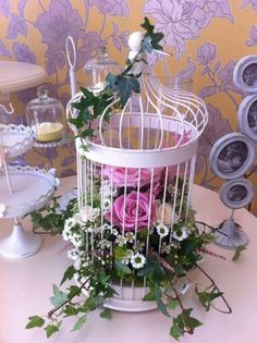 Birdcage wedding table centre, vintage pink roses wax flower mixed flowers and ivy made here at florist @ the swan