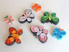 http://ladyrain.hubpages.com/hub/Paper-Quilling-Butterflies