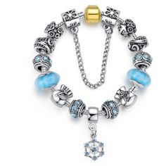 With hints of blue, silver and gold, this bracelet can be worn throughout the whole of winter. This unique gift has been designed to the highest specification, and includes intricate detailing through out. With a zirconia gem, the charm bracelet has a number of attractive beads fitted to a circular silver plated chain. Decorative, stylish, …