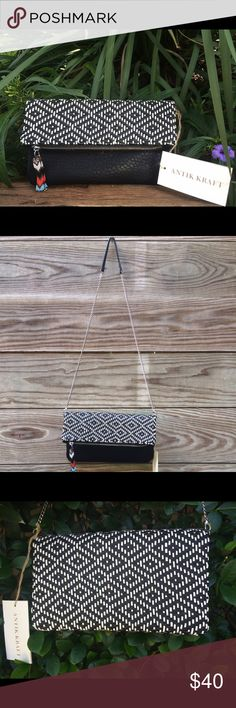 💕Antik Kraft Purse💕 It's a woven cross-body that can be turned into a clutch bag. The material feels like leather but at the same time it feels like straw. Color is black and white whit a beautiful pattern and a beaded zipper that accentuate the purse. 🎉Please see 📷 to see what I am talking about. Antik Kraft  Bags Crossbody Bags
