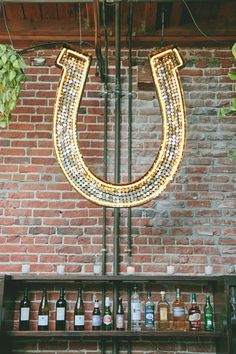 Giant Lighted Horseshoe - Wedding Decor | See the wedding on SMP: www.StyleMePretty... onelove photography onelove photography