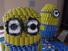 An awesome Canstruction food can sculpture- themed! Fruit Sculptures, Food Sculpture, Food Carving, Pumpkin Carving, Minion Christmas, Food Drive, Watermelon Carving, Garden Theme, Museum Exhibition