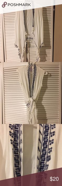 Francesca's collection vest/shirt White with fringe and beautiful embroidery. Looks awesome with skirt or jeans. Never worn Francesca's Collections Tops