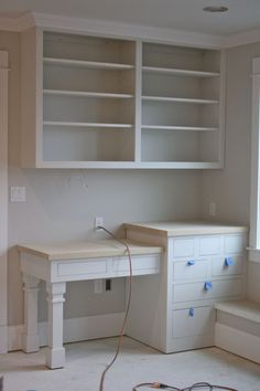 Built-in desk, bookcase, window seat. I wonder if there will be space for this somewhere? by karina
