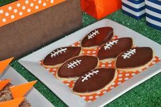 sugar cookie with frosting or also a mason jar full of popcorn with paper cover resembling football field