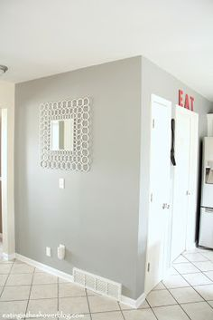 After two tries, some tears, and good advice from a friend, we got the gray wall color right with Benjamin Moore Platinum Gray. It is exactly what we wanted- never looks blue or lilac in any light.