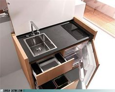 Must remember this clever design for a teeny tiny kitchen...maybe for the above garage apartment we've always wanted to build!