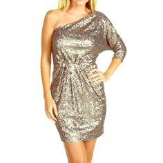 Trina Turk Shale Sequin Dress This one-shoulder shimmering sequin mini dress flaunts a three-quarter dolman sleeve at left shoulder and is perfect for glam and glitz. Color is pewter. FEATURES: Asymmetrical neckline. Gentle gathering at shoulder and waist. Side zip closure. Fully lined. 100% polyester. Hand wash cold, dry flat. Made in the U.S.A. Measurements: forthcoming Length: 36 in Trina Turk Dresses One Shoulder