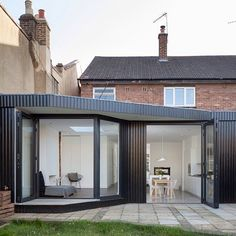 This extension to an east London residence features blackened wood cladding that references Japanese architecture and a dedicated walkway for cats via dezeen