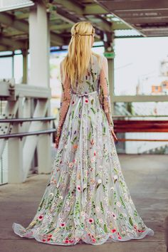 See the same dress white color here: https://www.etsy.com/listing/552755601/flower-wedding-dress-in-white-floral & the one in black here: https://www.etsy.com/listing/499441161/embroidered-formal-dress-floral-maxi This long wedding gown in gray color is made of unique embroidered fabric with tiny flowers, has long sleeves, round neckline and a built-in corset for an awesome support of your upper body! I individually approach each customer...