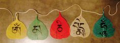 Tashi painted these Bodhi leaves from Bodh Gaya to create a delicate set of prayer flags that read Om Mani Padme Hum. facebook.com/tibetanart to learn more