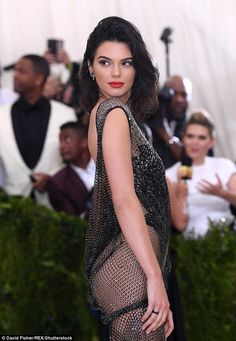 Kendall Jenner flashes flesh in crystal gown at Met Gala #dailymail