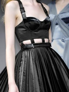 Bustier dress with cutout detail and pleated skirt.