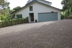 Natural Paving driveway at Mountain Road, Auckland. Outdoor Rooms, Outdoor Decor, Auckland, Stables, Landscaping, Garage Doors, Shed, Mountain, Outdoor Structures
