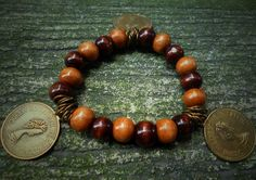 Plumeria Esmeralda Bracelet Wood Beads, charms and metals  Like us on https://www.facebook.com/plumeriajewelry