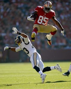 Vernon Davis #85 of the San Francisco 49ers leaps over would be tackler Rodney McLeod #23 of the St. Louis Rams during the first quarter at Candlestick Park on December 1, 2013 in San Francisco, California.